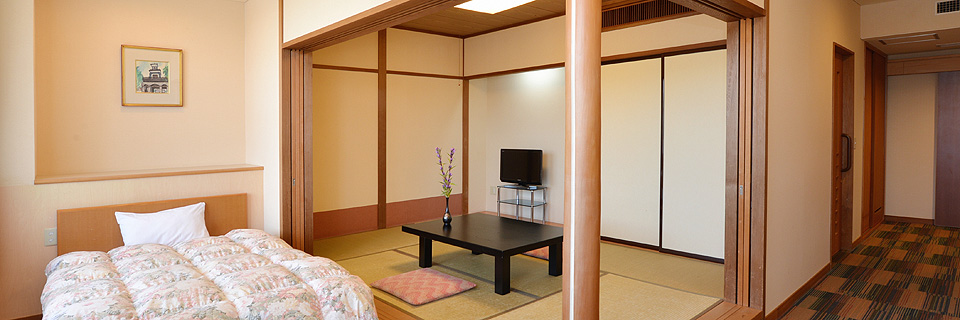 ホテルウェルネスの和洋室の写真